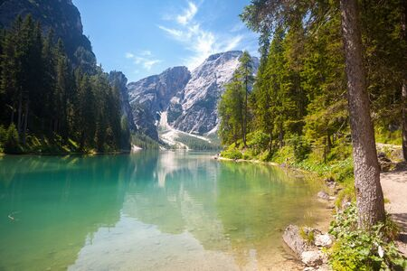 dolomite: Lake Braies with a turist path in the Dolomite Mountains, Italy Stock Photo
