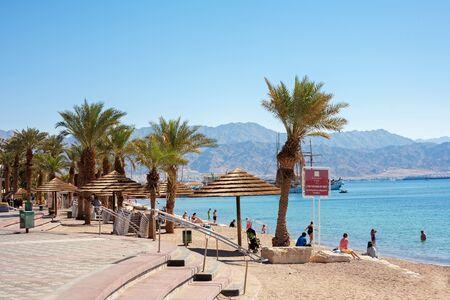 eilat: Eilat, Israel - February 11, 2016: People at the beach In Eilat, Israel