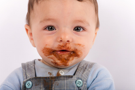 ate: Funny baby boy portrait after he ate  chocolate Stock Photo