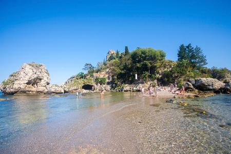 bather: Taormina, Italy - May 29, 2015: Tourists enjoying the beach at Isola Bella in Sicily