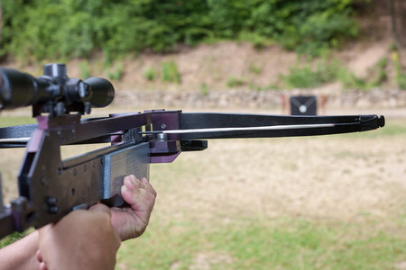 Targeting with a scoped crossbow Stock Photo