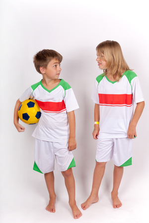 sibling rivalry: Siblings conflict concept - Sister arguing with her brother holding a soccer ball