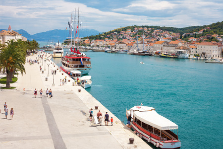 TROGIR, CROATIA - JUNE 19, 2014: The Old Town of Trogir at the pier and promenade, Croatia. UNESCO World heritage site. Trogir is a popular tourist destination near to Split city. Editorial
