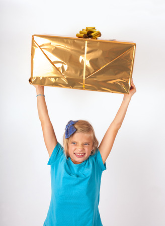 gladly: Happy Girl lifting her present above her head gladly