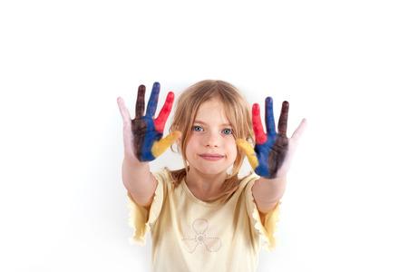 painted hands: Little schoolgirl showing her painted hands.