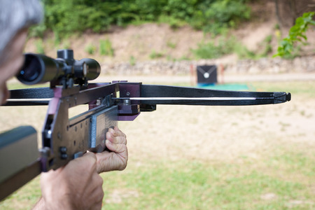 crossbow: Targeting with a scoped crossbow Stock Photo