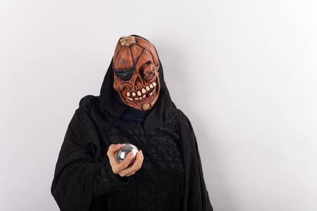 metal ball: Woman wearing halloween  costume holding a metal ball