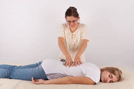 clothed: Bowen therapy of a young woman - back massage