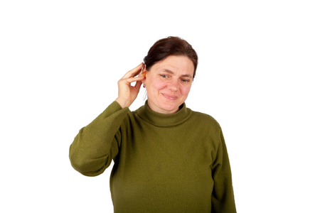 impaired: Hearing impaired woman putting on her hearing aid