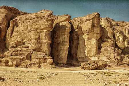 timna: The Famous Solomons Pillars in Timna Park near to Eilat, Israel. HDR landscape with vintage effects Stock Photo
