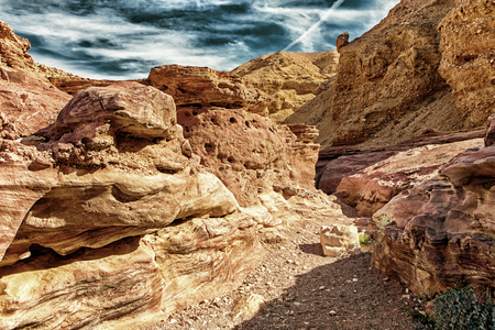 Bizarre rock formations from Red Canyon tourist attraction in Israel (HDR image with Black Gold filter)