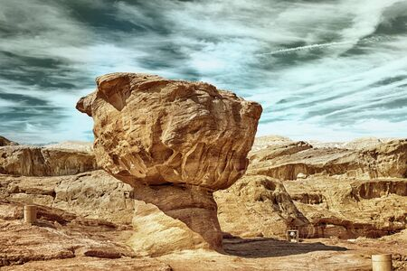 timna: The Mushroom sandstone geological feature in Timna Park near to Eilat, Israel (HDR image with black gold filter) Stock Photo