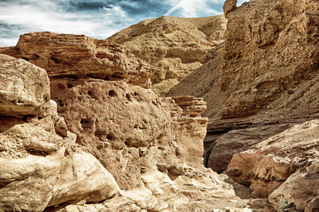 Travel in Israel: Red Canyon, giant cliffs (HDR image with black gold filter) Stock Photo