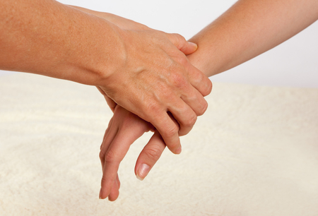 clothed: Bowen massage treatment of a hand.