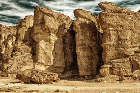 timna: The Famous Solomons Pillars - Geological attraction in Timna Park near to Eilat, Israel. The first copper mines in the history and the Hathor temple were here. (HDR image, black gold filter)  Stock Photo