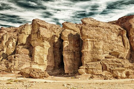 The Solomons Pillars geological and historical place in Timna Park near to Eilat, Israel.  (HDR image with black gold filter)  Stock Photo