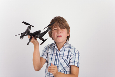 hist: Young boy playing with hist drone