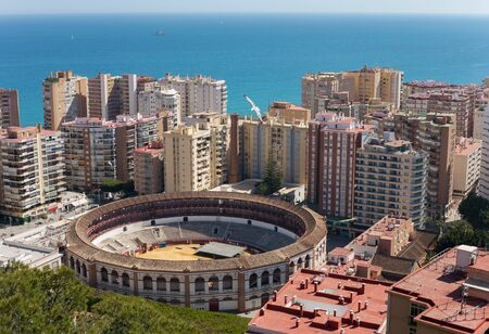 Aerial view of the Bullring and the city with the sea in Malaga, Spain Editorial