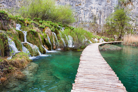 Winding  tourist pathway and waterfalls in Plitvice Lakes National Park, Croatia