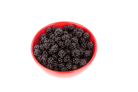 berry: A bowl of fresh blackberry from the forest. Isolated on white white background. Stock Photo