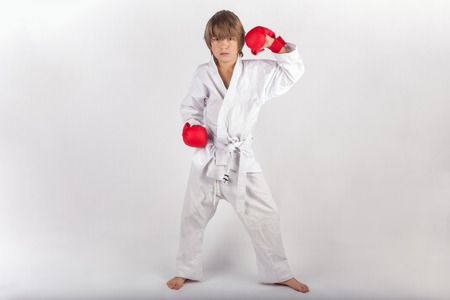 Karate kid with red boxing gloves posing Stock Photo