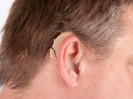 Close up of a senior mans ear with hearing aid 版權商用圖片