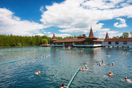 Heviz, Hungary - May 26, 2017: Lots of bathers in Heviz Spa. Lake Heviz is the 2nd largest natural thermal lake in the world. Editorial
