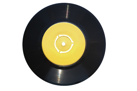 Single vinyl record (45 rpm) with empty yellow label suitable for texts. Isolated on white background. Clipping path included!