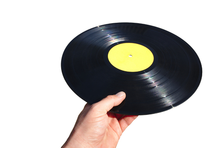 Hand holding a vinyl record isolated on white