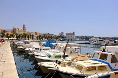 Split city boat harbor with the promenade in the background in Croatia