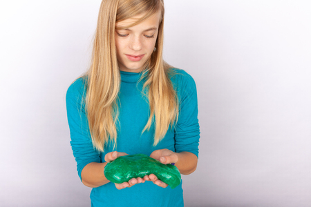 Cute girl playing with slime