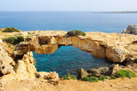 natural arch: Thin stone arch over sea. Agia Napa, Cyprus Stock Photo