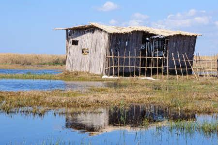 ramshackle: Poor cane abode on rushy lake shore Stock Photo