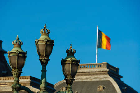 old town guildhall: Waving Belgian Flag in the old lamp background