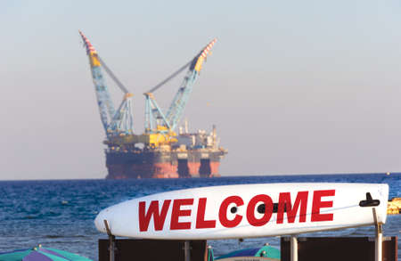 Gas and oil rig in Cyprus. Offshore exploration platform near beach