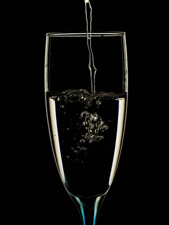 Elegant picture in glasses is poured with clean water on a black background