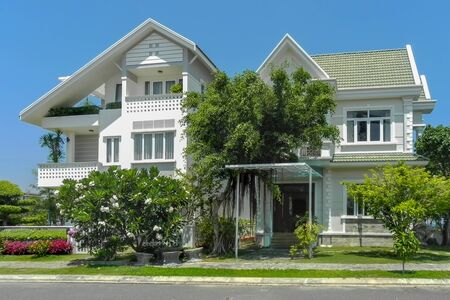 two beautiful  houses with  trees, and landscape design in the summer. An Vien. Nha trang. Vietna. Stockfoto