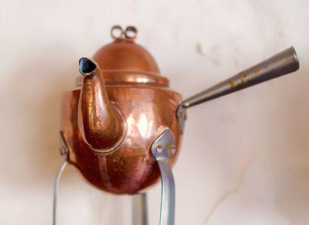 Copper coffee pots for home interior. Old copper kettle