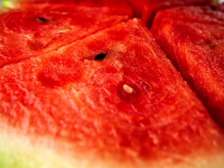 Slice of ripe and juicy watermelon, close-up. triangular slices of fresh watermelon with seeds.