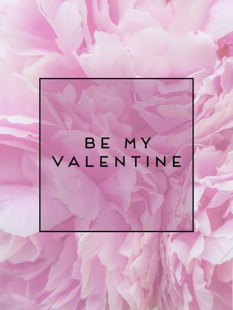 text be my valentine in the frame against the background of pink peonies flowers. postcard.