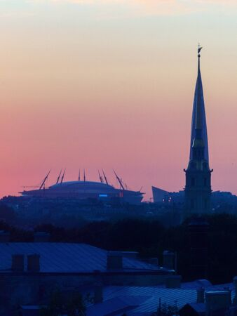 ST. PETERSBURG. RUSSIA - August 28, 2019. Krestovsky stadium, the Lakhta Center skyscraper and the Peter and Paul Fortress against a bright sunset sky. Redakční
