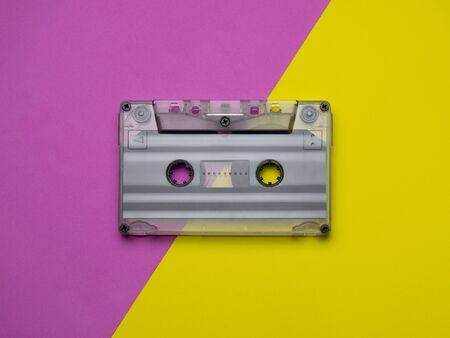 Retro cassettes on a yellow and pink background. view from above. copy space.