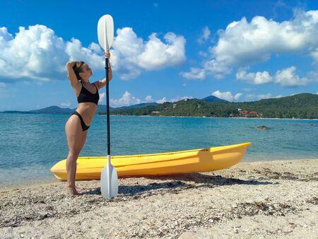 Brunette girl kayaking through lover's key kayak trail.