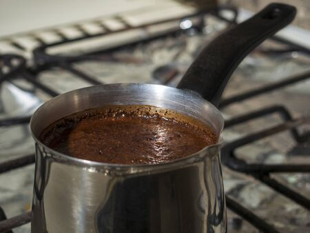 ground coffee is brewed in a steel Turk.