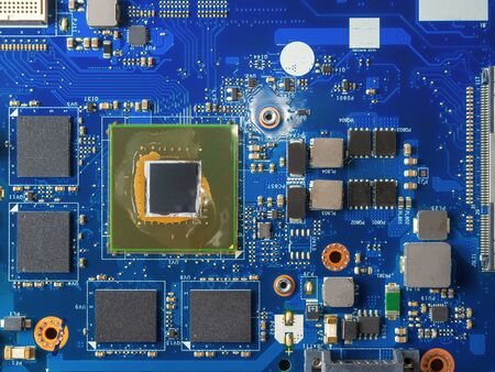 Close up of a printed blue computer circuit board