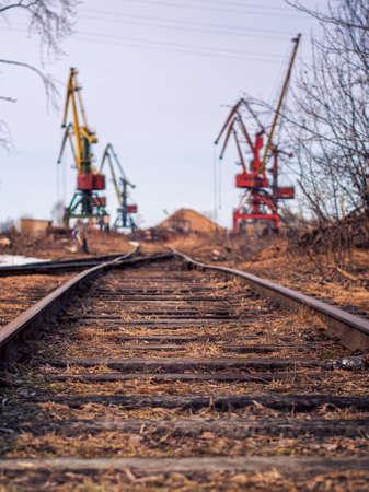 Rail road tracks under the gantry cranes on the berth of sea merchant port