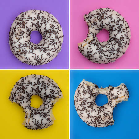 Colorful delicious donut in a row, bitten