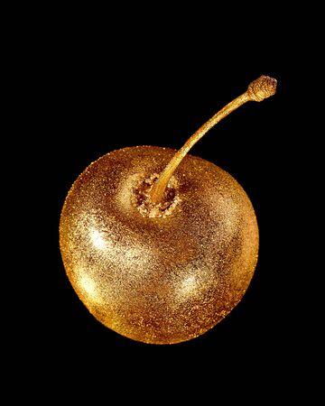 bulling: dorado brillante estudio aislado cereza brillante, fondo negro