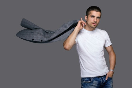 clothing model: young man waving his jacket, studio portrait