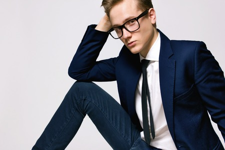 casual fashion: Male Model wearing a jacket and glasses Stock Photo